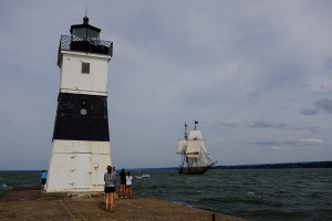 Flagship Niagara Enters the Channel at the North Pier Light